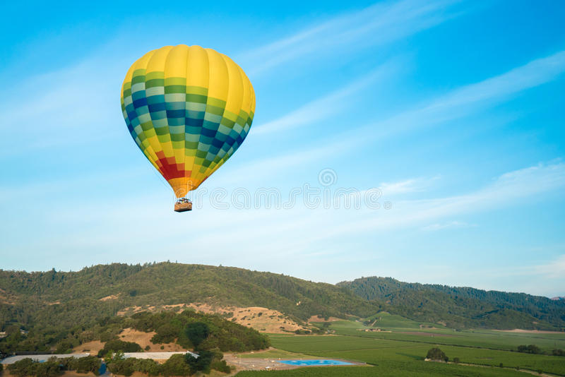 Hot Air Balloons Floating Above Vineyards stock image