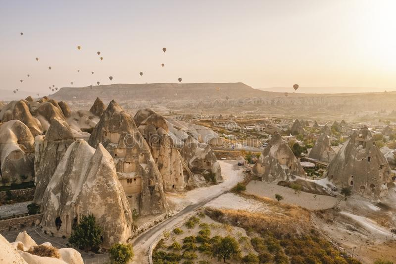 Hot air balloons flying over the famous landscape of Cappadocia, Turkey stock photo