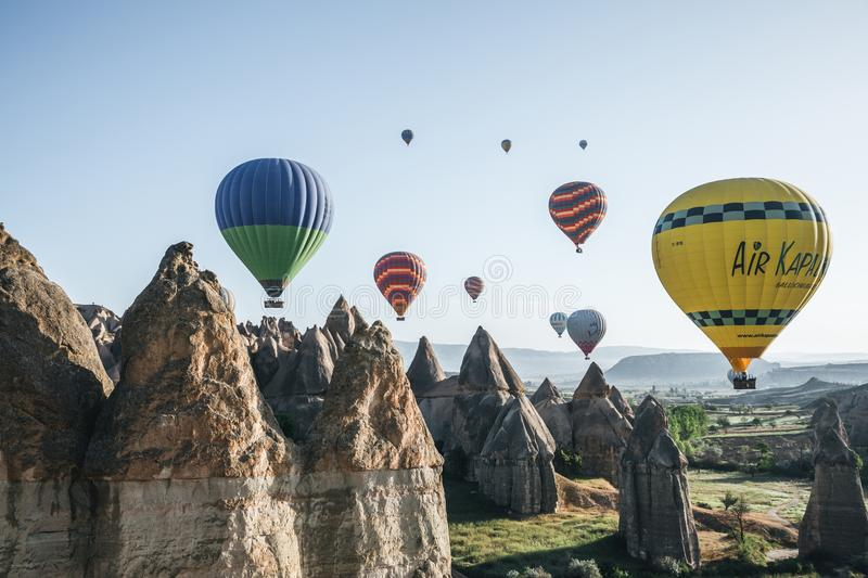 hot air balloons flying in sky above majestic rock formations in famous cappadocia, turkey В В В  stock photography