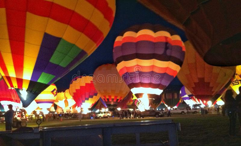 Glowing hot air balloons royalty free stock photo