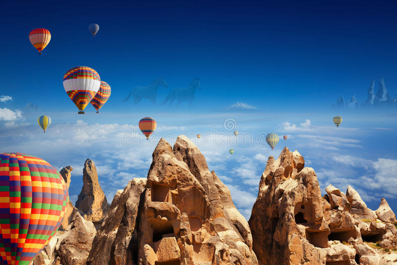 Hot air balloons, hand carved rooms in rocks, two running horses. Beautiful collage of symbols of Cappadocia - flying hot air balloons, hand carved rooms in royalty free stock images