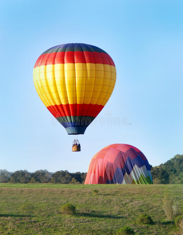 Hot Air Balloons landing stock photo