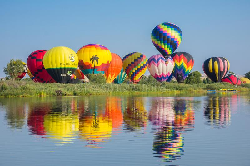 Hot Air Balloons Liftoff. Colorful Reflections In Water stock photos