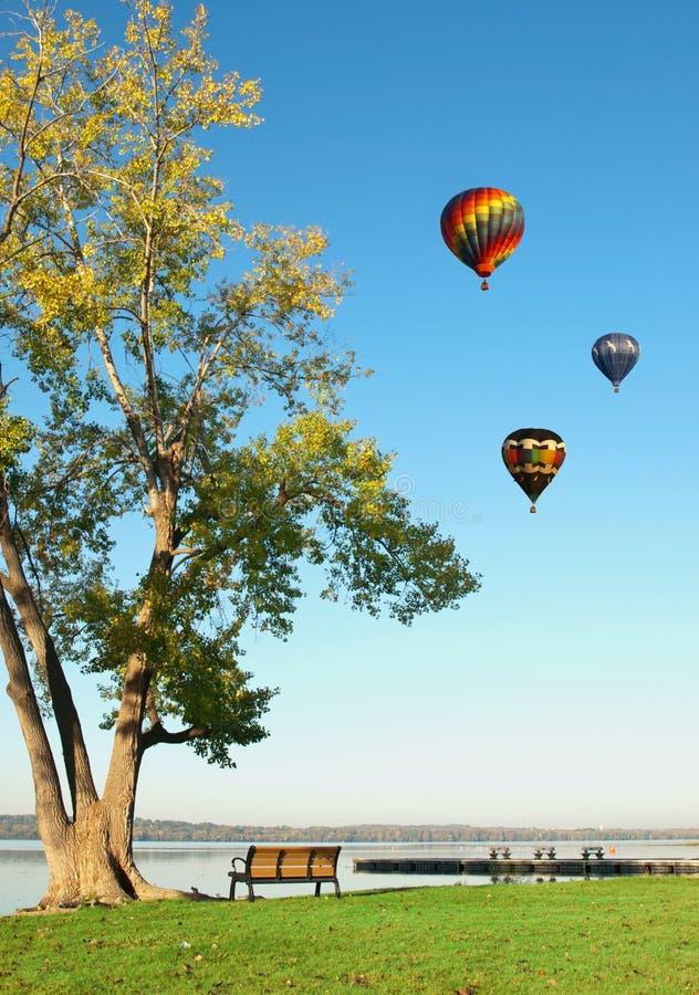 Hot air balloons over lake royalty free stock photo