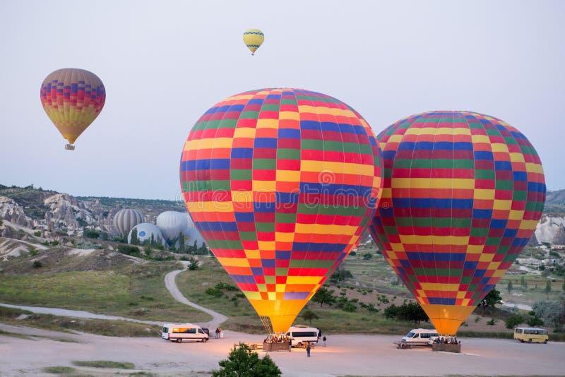 Hot air balloons over mountain landscape in Cappadocia, Goreme National Park, Turkey. royalty free stock photos