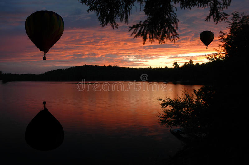 Hot-Air Balloons Over Water At Sunset Sunrise Stock Image