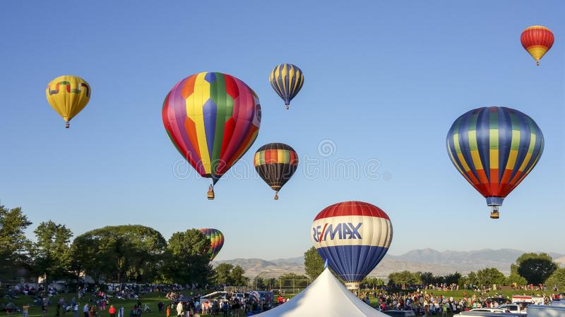 Hot air balloons rise in the morning at the Sandy Hot Air Balloon Festival stock photo