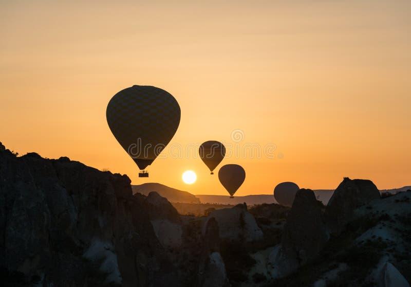 Hot air balloons at sunrise stock image