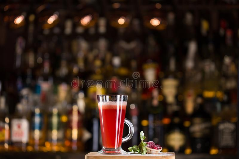 Hot alcoholic cocktail of sangria and cranberry nectar. Decorated with honey and lingonberry jam stock images