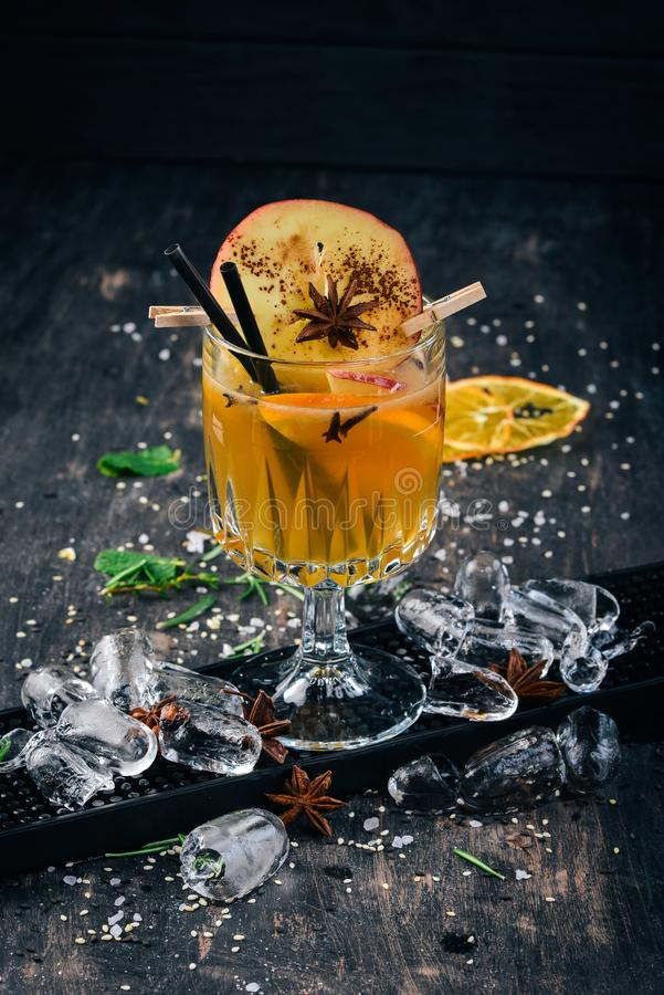 Hot alcoholic cocktails Hroh with apple. stock photo
