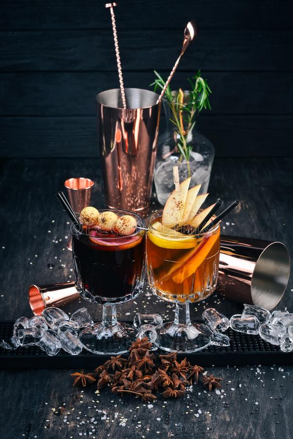 Hot alcoholic cocktails with wine, cinnamon and apples. stock photo
