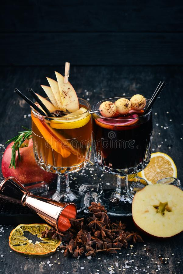 Hot alcoholic cocktails with wine, cinnamon and apples. royalty free stock photo