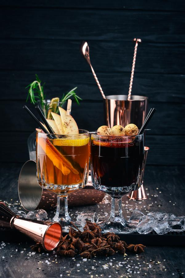 Hot alcoholic cocktails with wine, cinnamon and apples. stock photos
