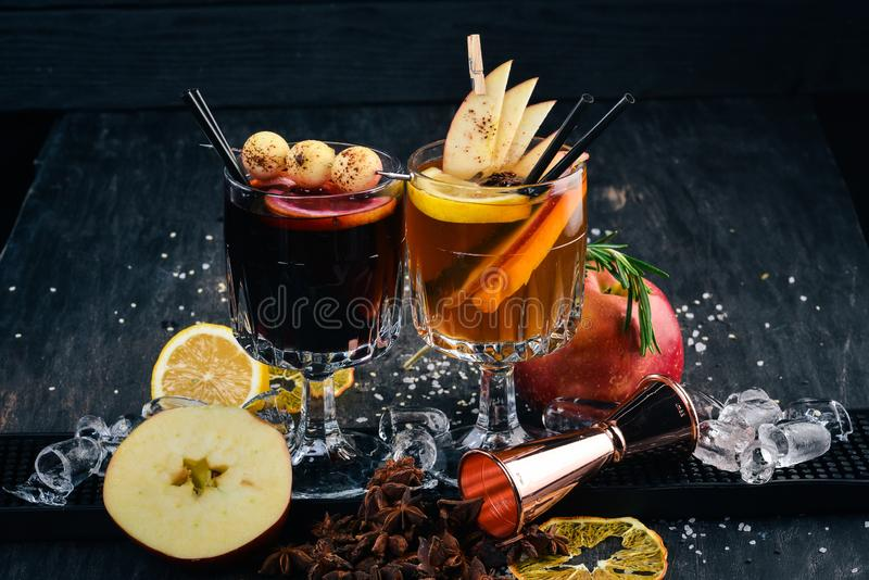 Hot alcoholic cocktails with wine, cinnamon and apples. stock image
