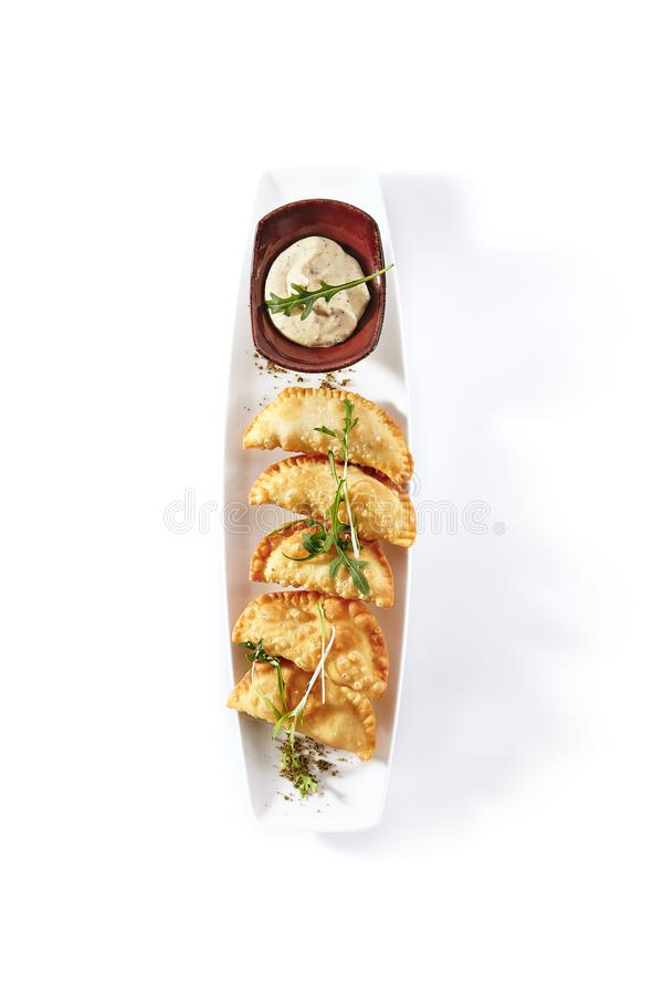 Hot Appetizers with Mini Chebureki, Cheese and Greens stock images