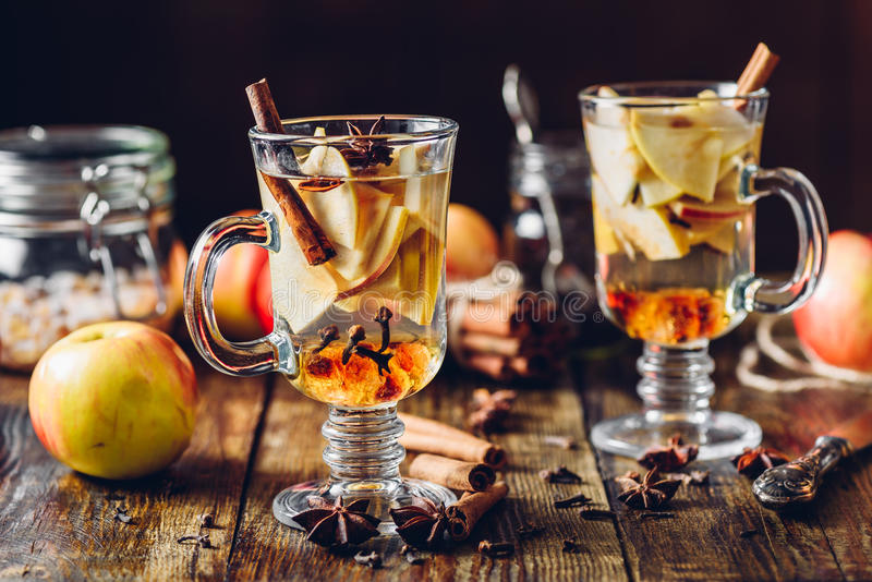 Hot Apple Cider. And Ingredients on Wooden Table stock images