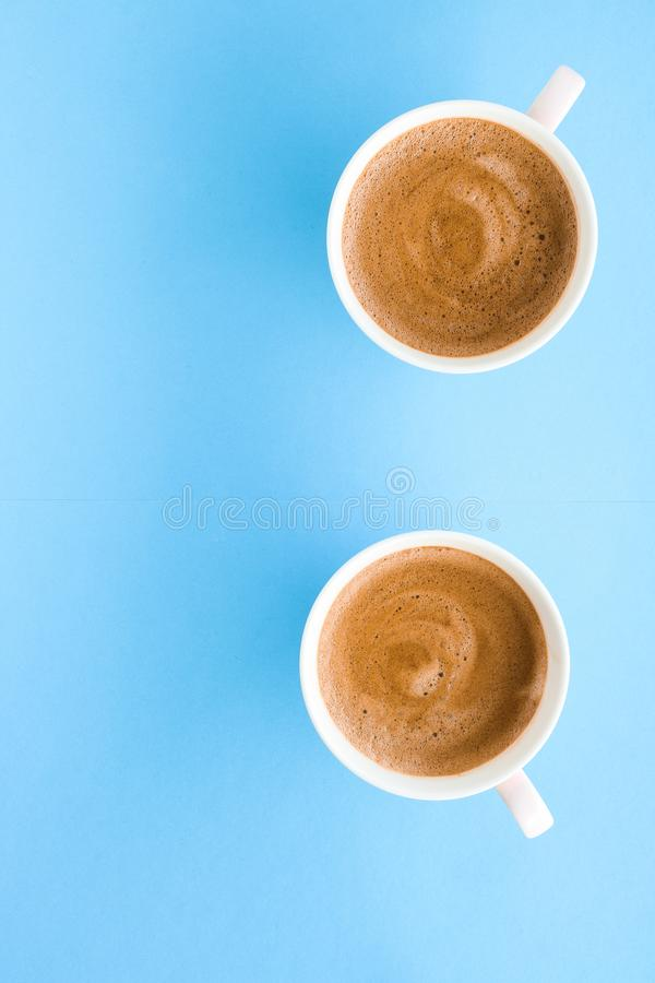 Hot aromatic coffee on blue background, flatlay. Breakfast, drinks and modern lifestyle concept - Hot aromatic coffee on blue background, flatlay royalty free stock photography