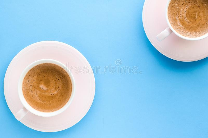 Hot aromatic coffee on blue background, flatlay. Breakfast, drinks and modern lifestyle concept - Hot aromatic coffee on blue background, flatlay royalty free stock photo