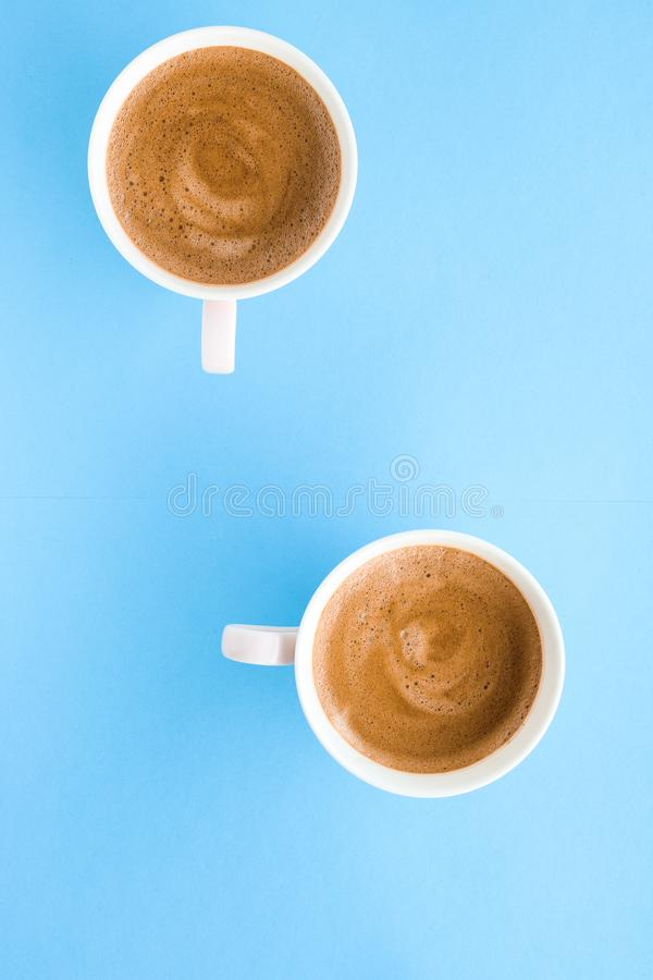 Hot aromatic coffee on blue background, flatlay. Breakfast, drinks and modern lifestyle concept - Hot aromatic coffee on blue background, flatlay stock images