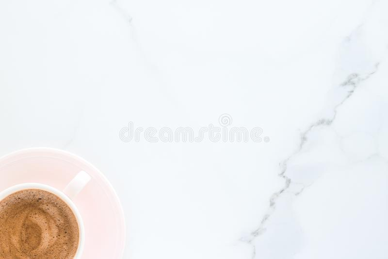 Hot aromatic coffee on marble, flatlay. Breakfast, drinks and modern lifestyle concept - Hot aromatic coffee on marble, flatlay royalty free stock photography