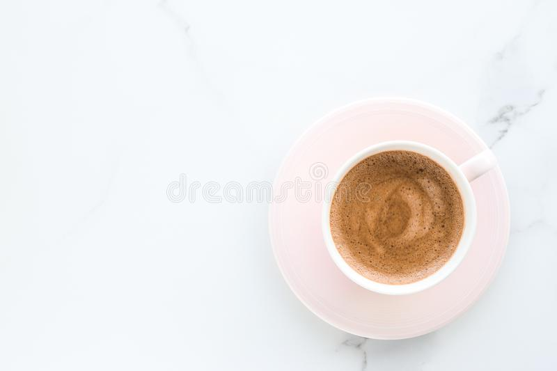 Hot aromatic coffee on marble, flatlay. Breakfast, drinks and modern lifestyle concept - Hot aromatic coffee on marble, flatlay stock photo