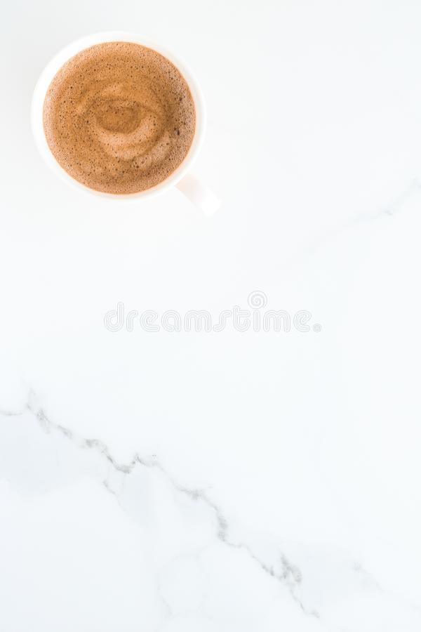 Hot aromatic coffee on marble, flatlay. Breakfast, drinks and modern lifestyle concept - Hot aromatic coffee on marble, flatlay royalty free stock photos