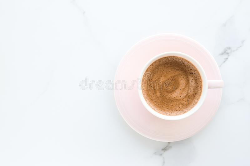 Hot aromatic coffee on marble, flatlay. Breakfast, drinks and modern lifestyle concept - Hot aromatic coffee on marble, flatlay stock photos