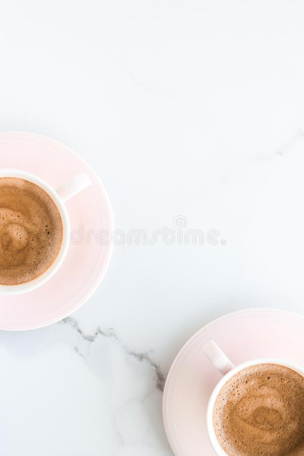 Hot aromatic coffee on marble, flatlay. Breakfast, drinks and modern lifestyle concept - Hot aromatic coffee on marble, flatlay royalty free stock image