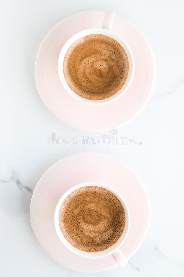 Hot aromatic coffee on marble, flatlay. Breakfast, drinks and modern lifestyle concept - Hot aromatic coffee on marble, flatlay stock photography