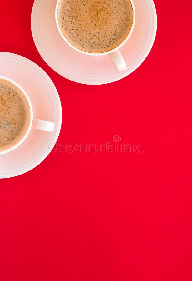 Hot aromatic coffee on red background, flatlay. Breakfast, drinks and modern lifestyle concept - Hot aromatic coffee on red background, flatlay stock photos