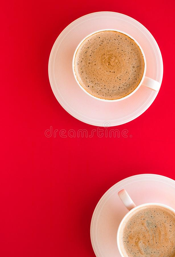 Hot aromatic coffee on red background, flatlay. Breakfast, drinks and modern lifestyle concept - Hot aromatic coffee on red background, flatlay royalty free stock image