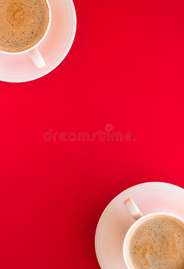 Hot aromatic coffee on red background, flatlay. Breakfast, drinks and modern lifestyle concept - Hot aromatic coffee on red background, flatlay royalty free stock images