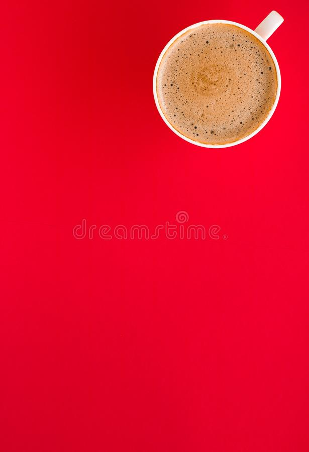 Hot aromatic coffee on red background, flatlay. Breakfast, drinks and modern lifestyle concept - Hot aromatic coffee on red background, flatlay stock image