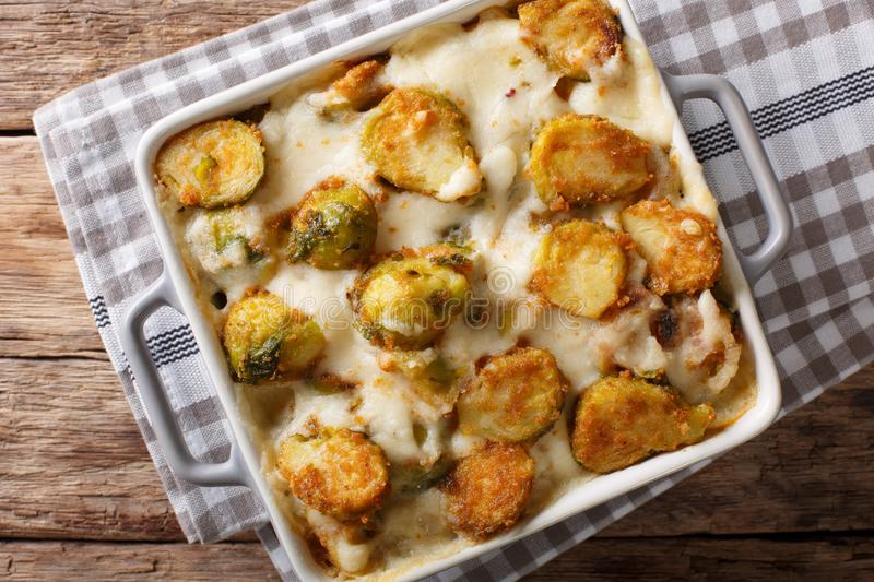 Hot baked Brussels sprouts with garlic, cheese and cream sauce c. Lose-up on the table. horizontal top view from abovel stock photo