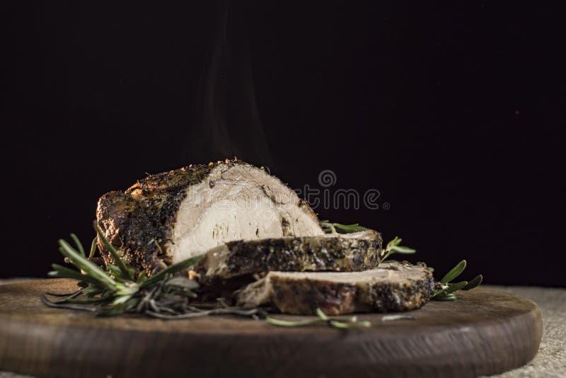 Hot baked ham and rosemary stock photos