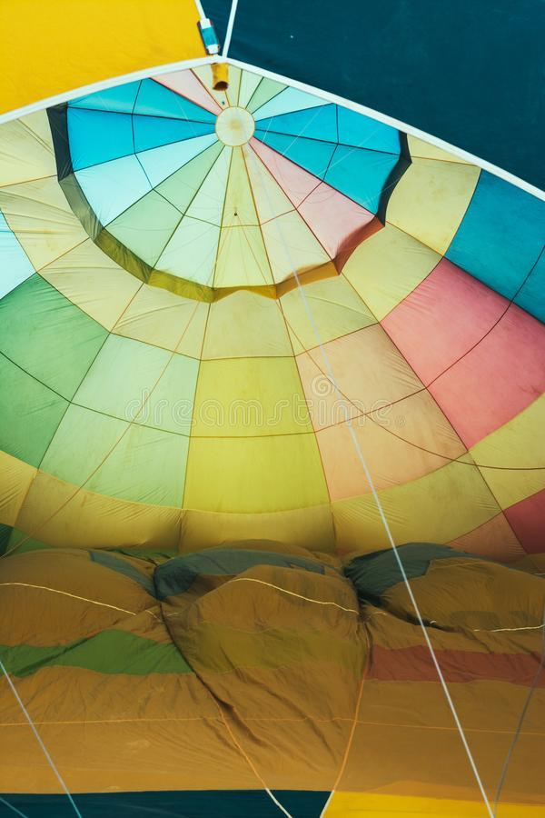 Hot ballon air, interior detail during inflation. balloon festival Aranjuez, Spain. Yellow and colofull fabric stock photo