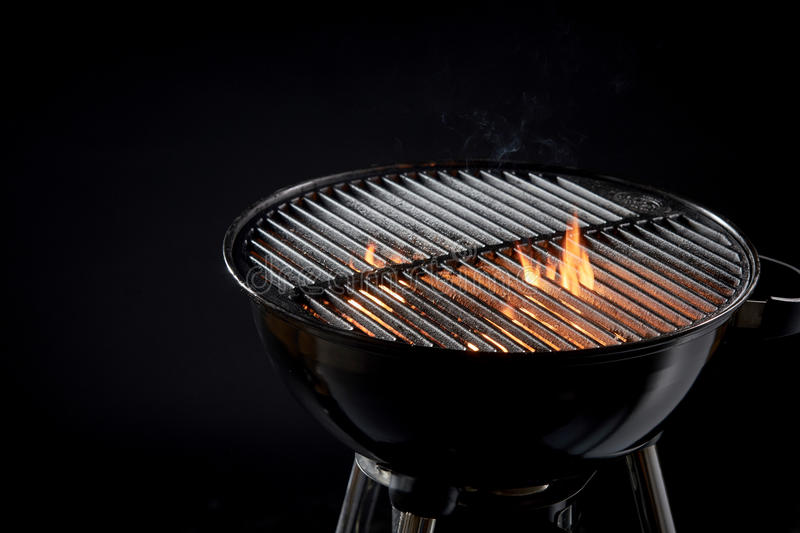 Hot barbecue fire with glowing coals ready to cook stock images