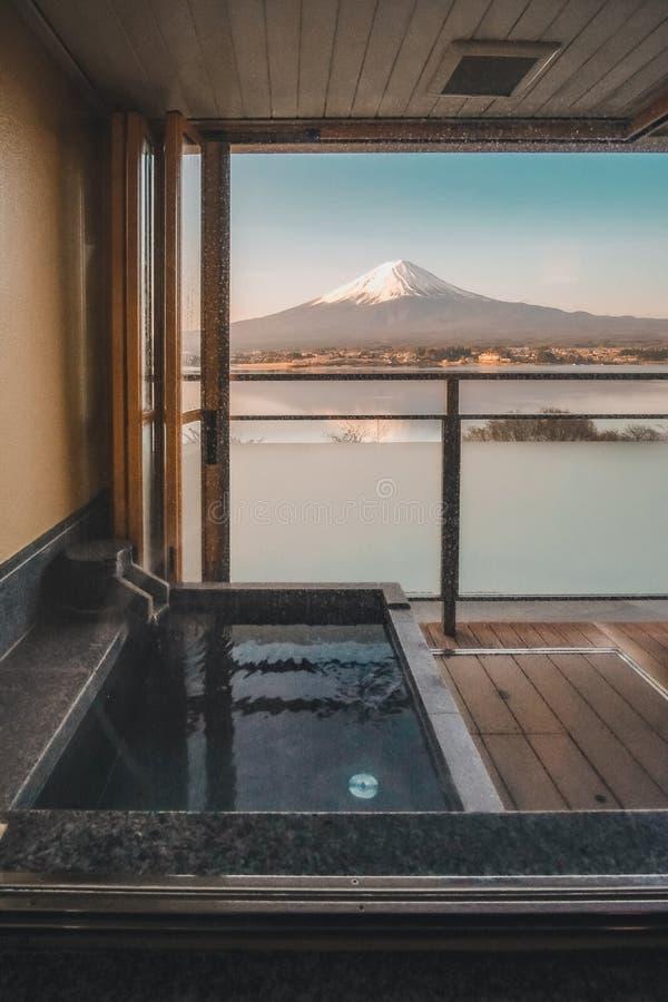 Hot bath Japanese onsen in Traditional ryokan resort with beautiful Mt.Fuji view background at Kawaguchiko lake, Yamanashi, Japan royalty free stock photography