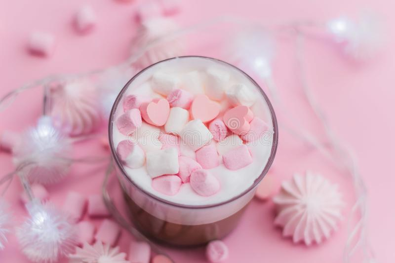 Hot beverage with whipped cream,marshmallows and heart shaped chocolate candies stock images
