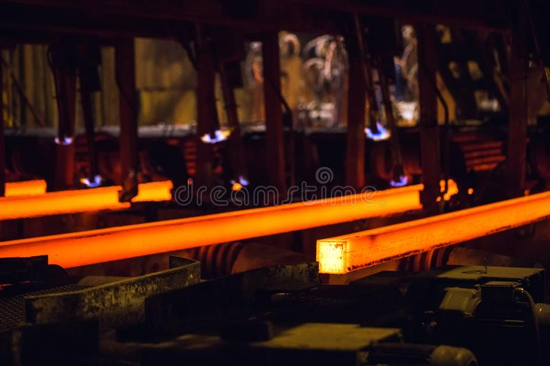 Hot billet bloom continuous casting, also called strand casting.  stock image