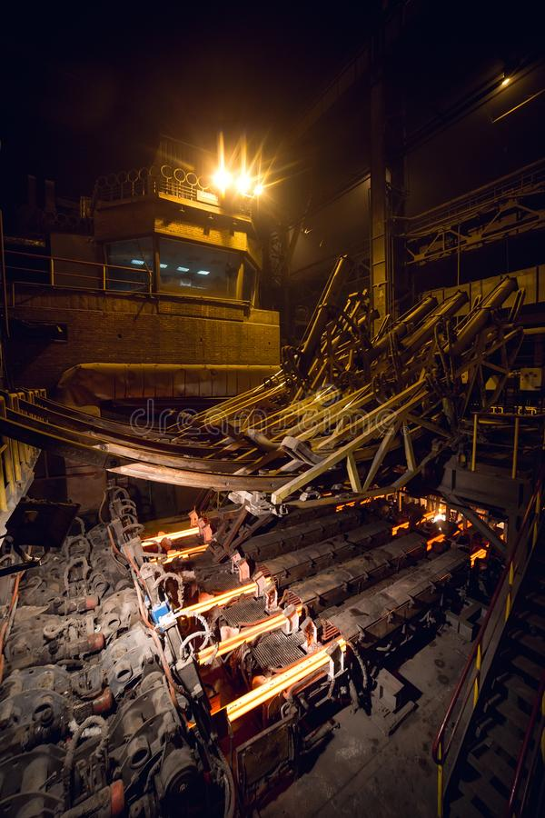 Hot billet bloom continuous casting, also called strand casting.  royalty free stock photography