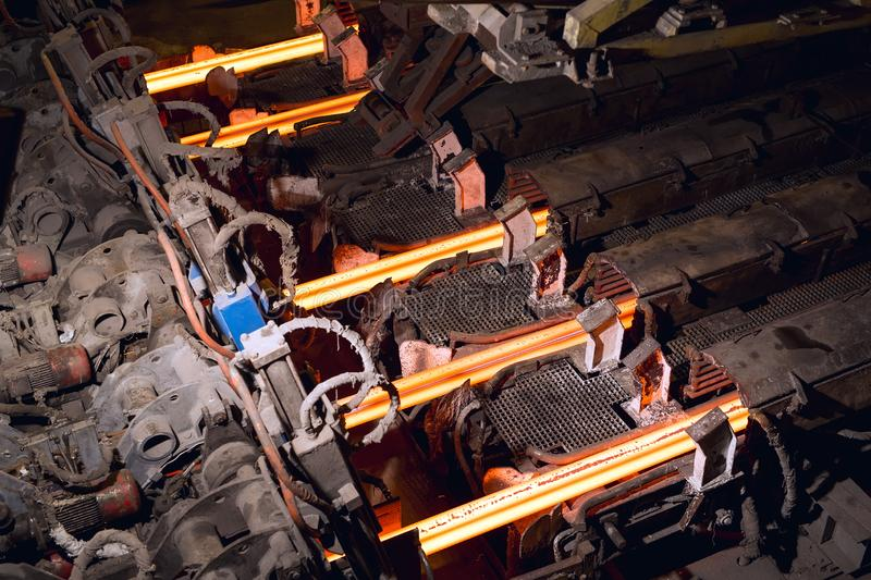 Hot billet bloom continuous casting, also called strand casting.  royalty free stock photo