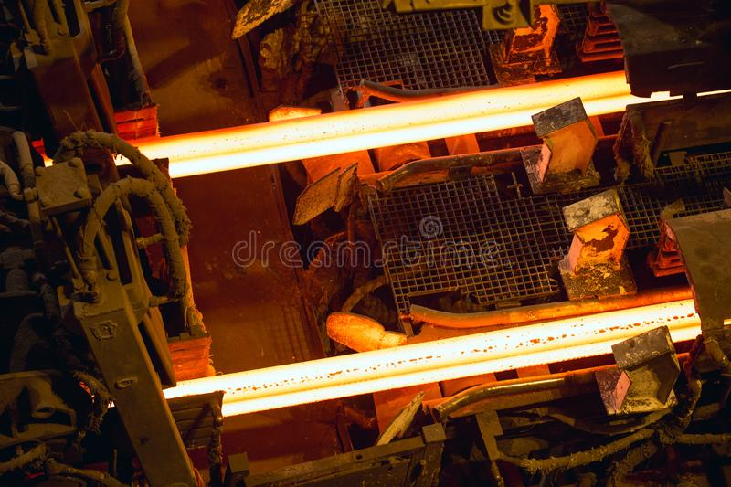 Hot billet bloom continuous casting, also called strand casting. Hot billet bloom continuous casting, also called strand casting royalty free stock photos