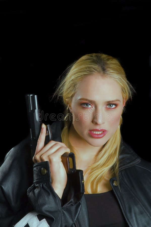 Hot blond with a gun royalty free stock images
