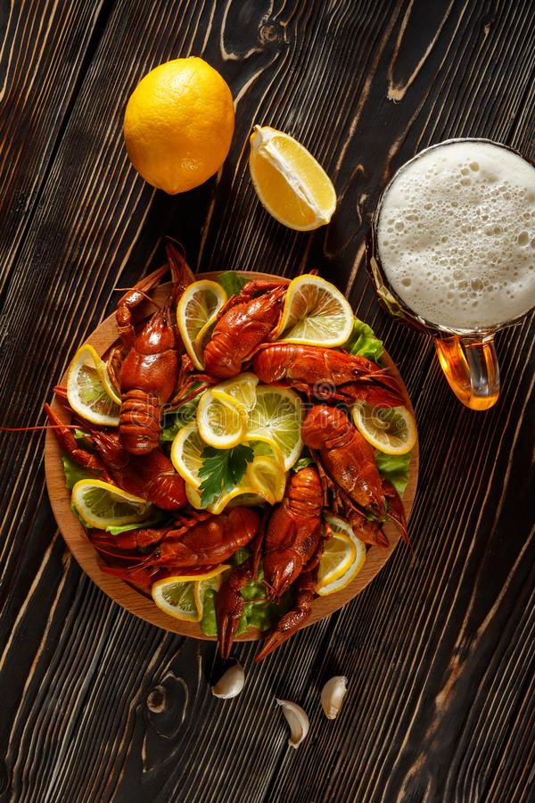 Hot boiled crawfish with a mug of beer and lemon royalty free stock photo