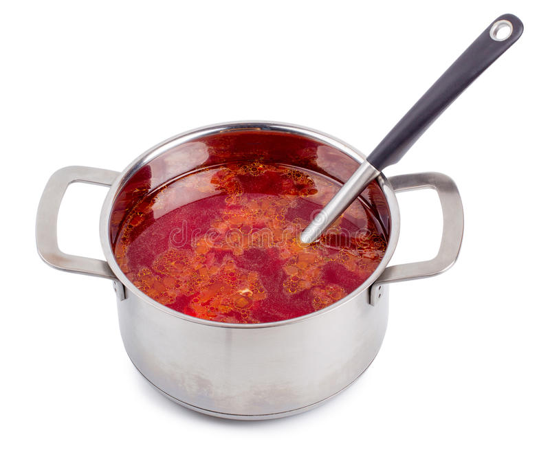 Hot borsch in a steel pan isolated. On a white background stock photography