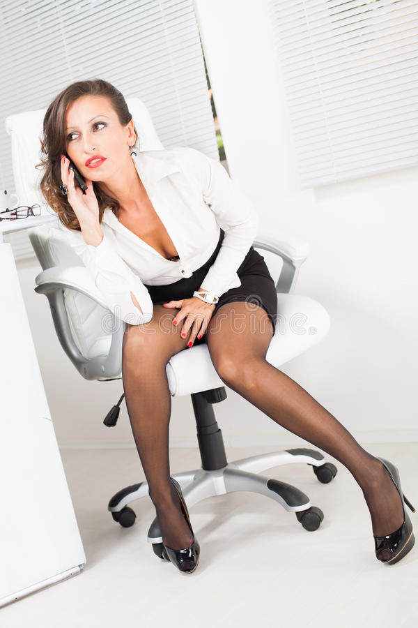 Hot business woman royalty free stock photography