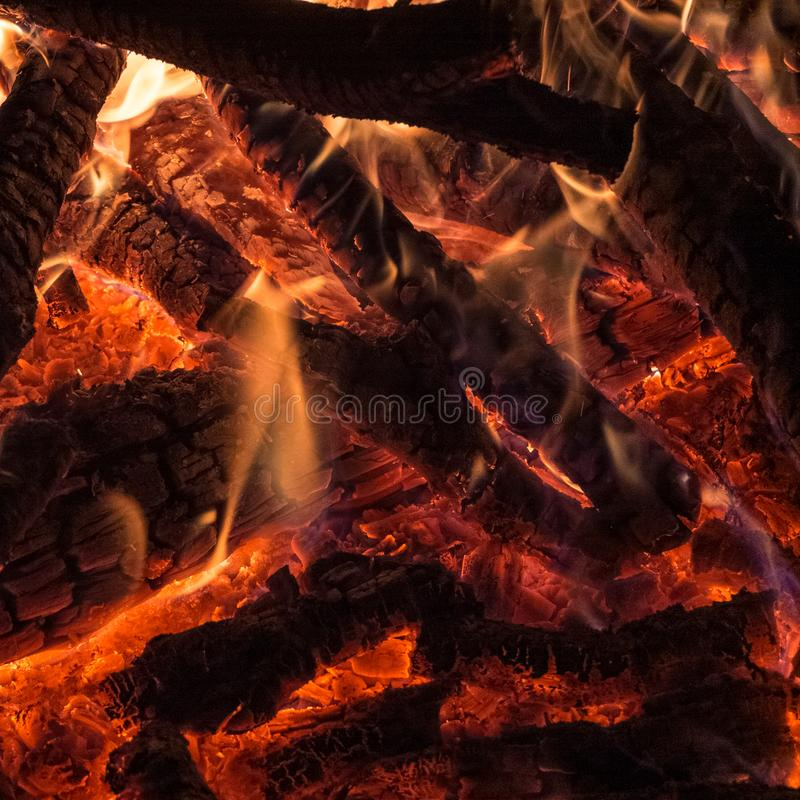 Hot campfire place full of crackling fire wood stock image