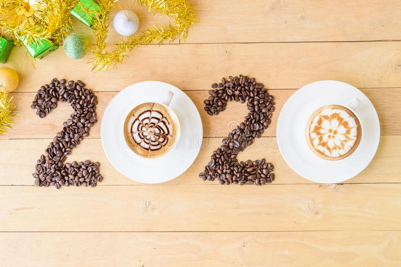 Hot cappuccino with coffee bean in 2020 year sign royalty free stock photography