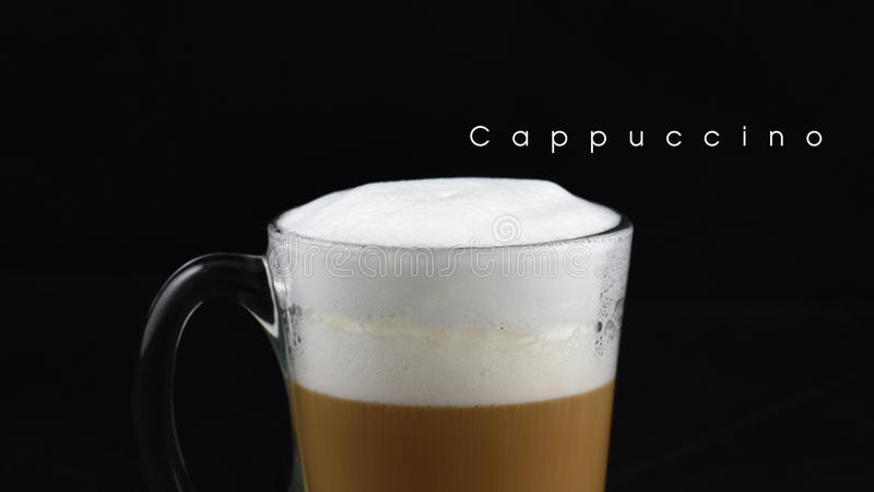 Hot cappuccino coffee with milk layer. Hot cappuccino coffee with milk layer royalty free stock photo